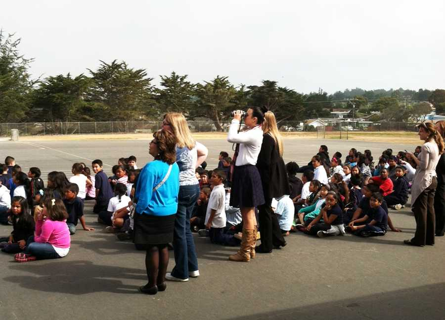 Kids at Ord Terrace Elementary School in Seaside waiteagerlyfor Endeavour to flyby.