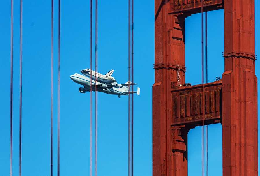Endeavour is seen flying past the Golden Gate Bridge in San Francisco.
