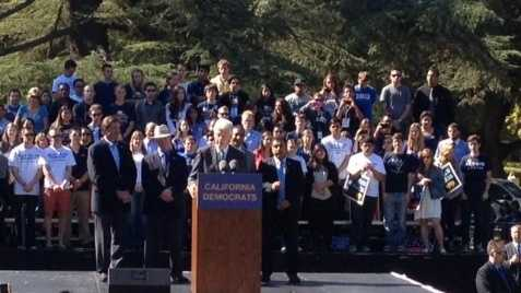 Former U.S. President Bill Clinton speaks to college students Tuesday.