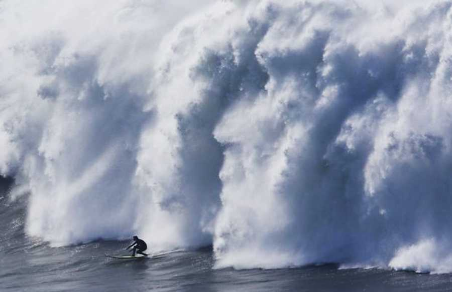 A surfer being used as a stunt double for Johnny Weston tries to beat this Mavericks wave during filming.