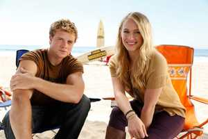Actor Johnny Weston and actress Leven Rambin pose for a photoshoot.