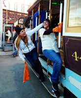 Two super excited SF Giants fans hop on the rally trolley near AT&T Park.