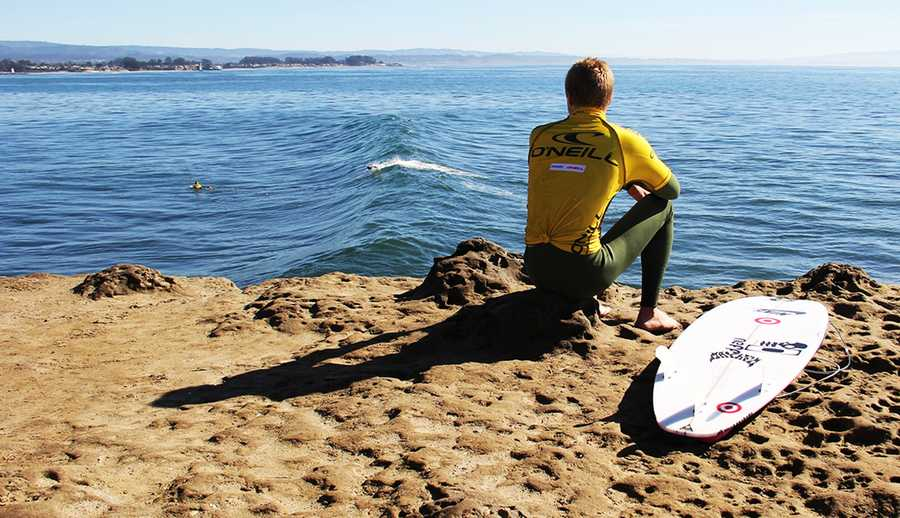 Surfers jump off a cliff, literally, to enter Steamer Lane.