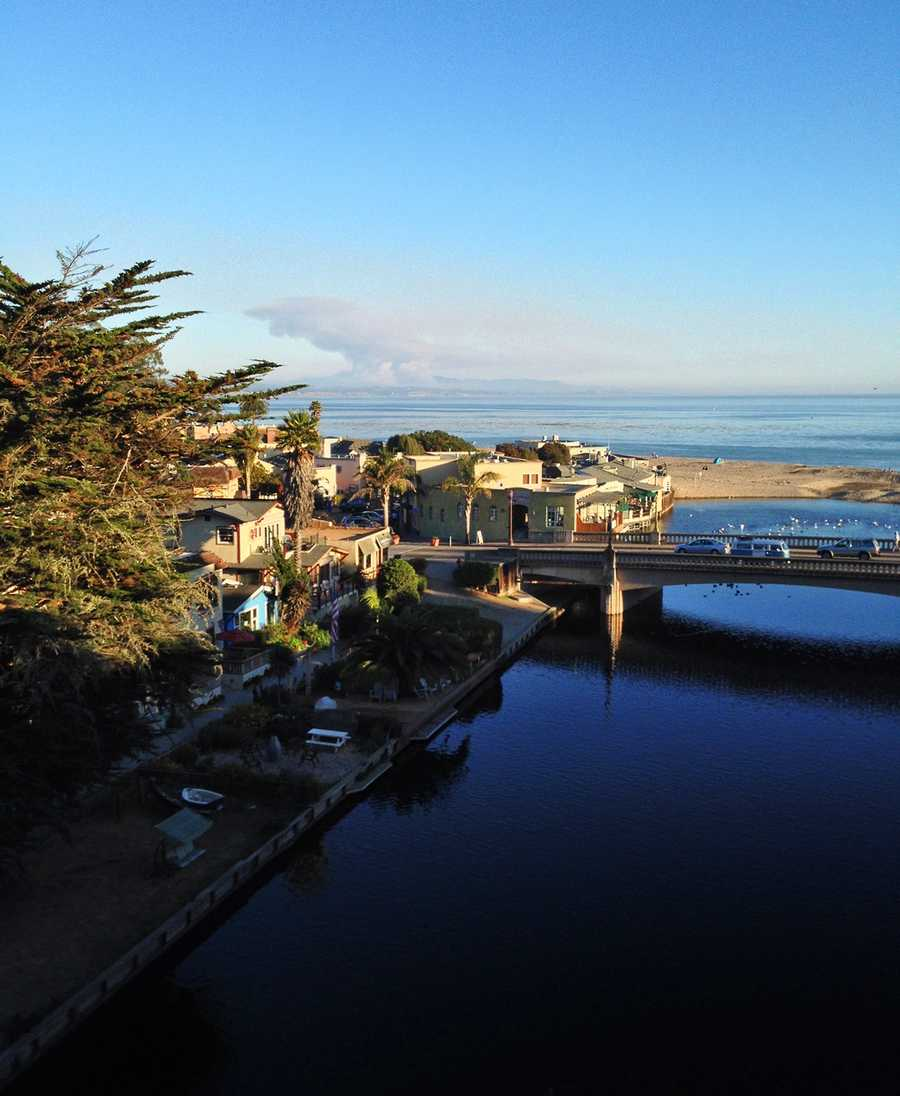 Two thick columns of smoke rose high into the air that could be seen from as far north as Santa Cruz. Jenelle Frias shot this photograph from Capitola Village.