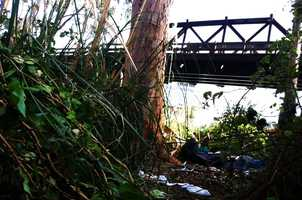 Charles Powers, a 51-year-old homeless man was stoned by a crowd throwing rocks and beaten with a skateboard under this train trestle in Santa Cruz on Nov. 16, 2012.