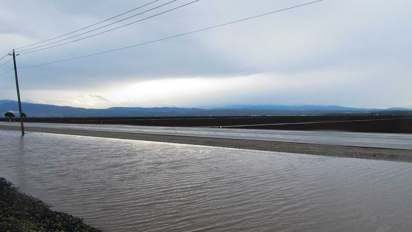 Water rises next to Highway 183 between Salinas and Castroville.