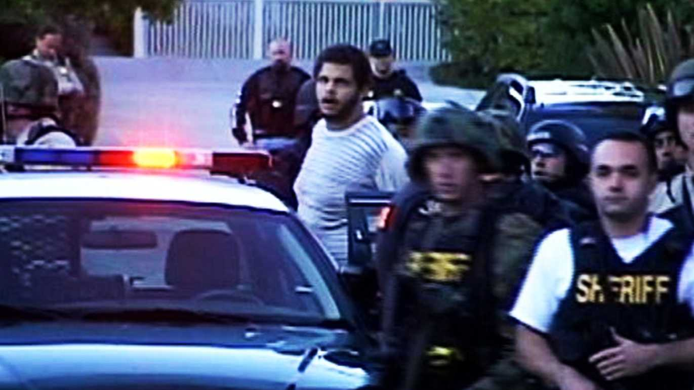 Maurice Ainsworth is seen being arrested after the 5-hour rampage in Santa Cruz on Nov. 29, 2010.