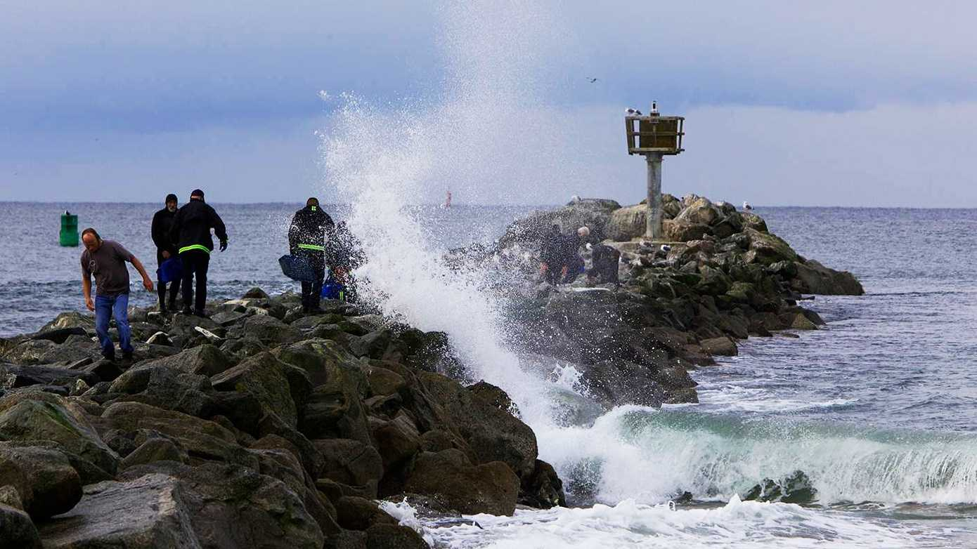 A man was found unconscious on his surfboard in Moss Landing Friday morning.