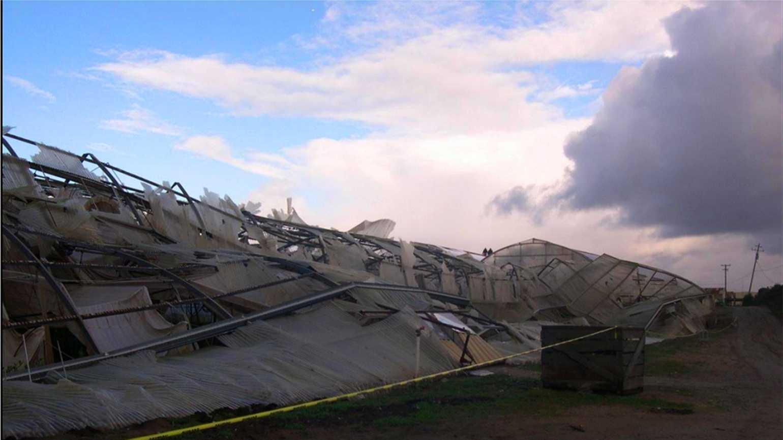 Damage from Saturday's tornado in Watsonville is seen.