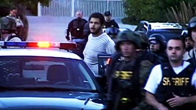 Maurice Ainsworth is seen being arrested in Santa Cruz on Nov. 29, 2010.