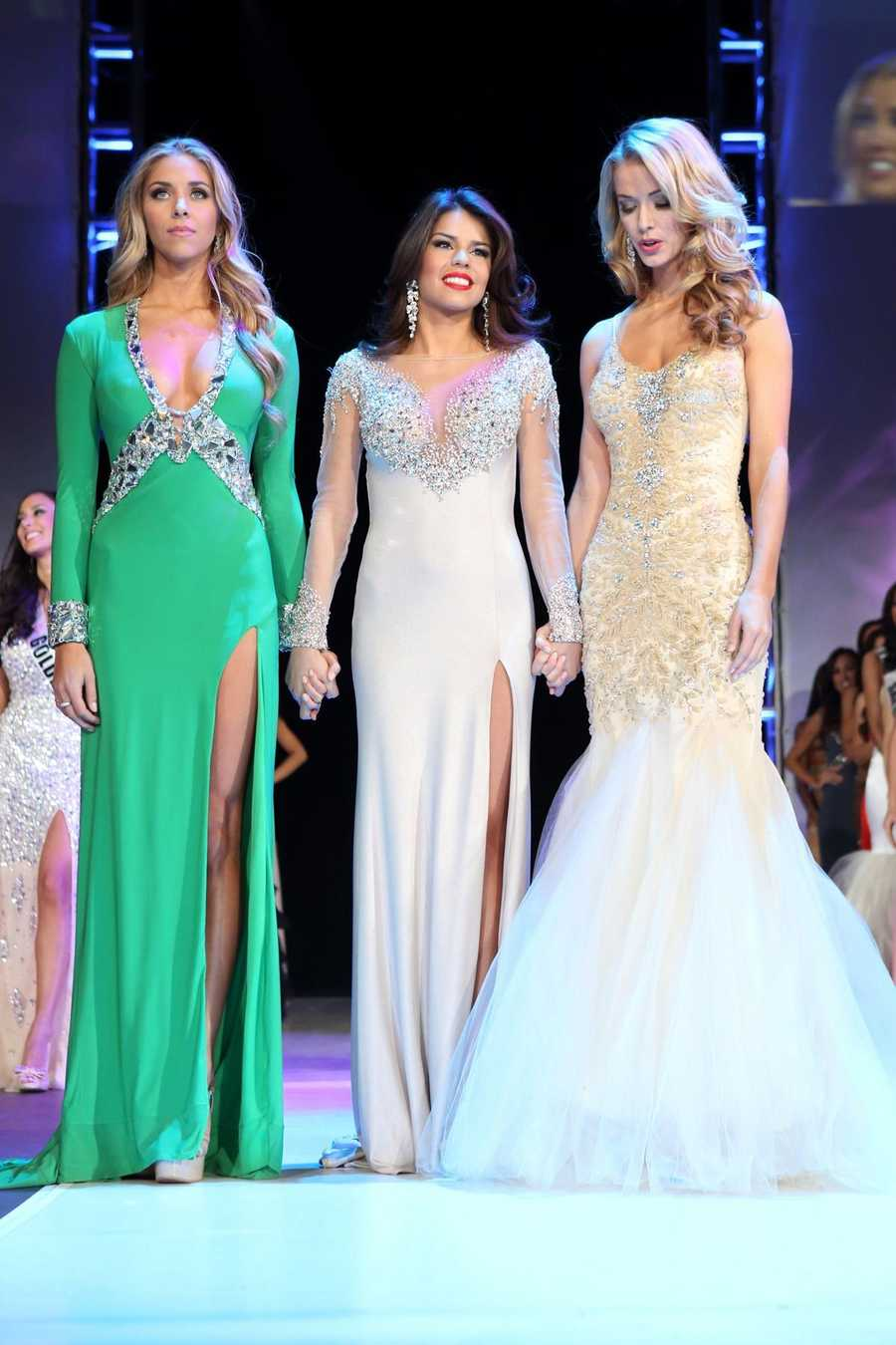 The three remaining competitors wait for the Miss California USA 2013 winner and runner-up to be announced.