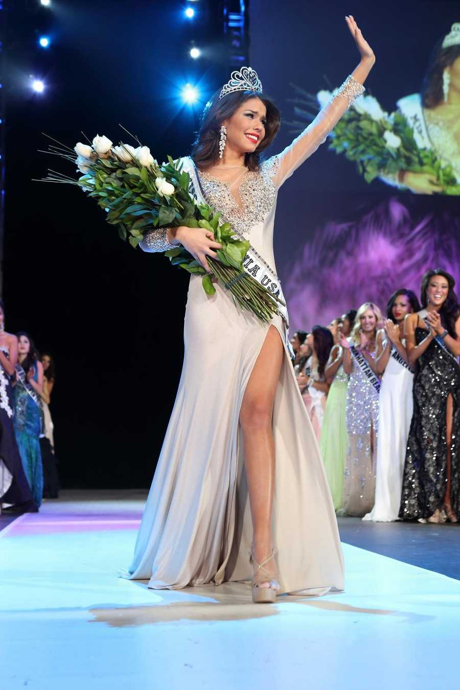 Miss Greater San Diego Mabelynn Capeluj smiles after she is crowned Miss California USA 2013.