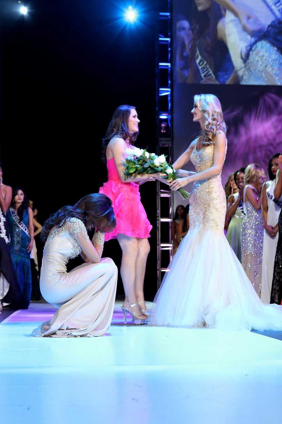 Miss Greater San Diego Mabelynn Capeluj, left, is emotional after the judges announce that she is Miss California USA 2013.