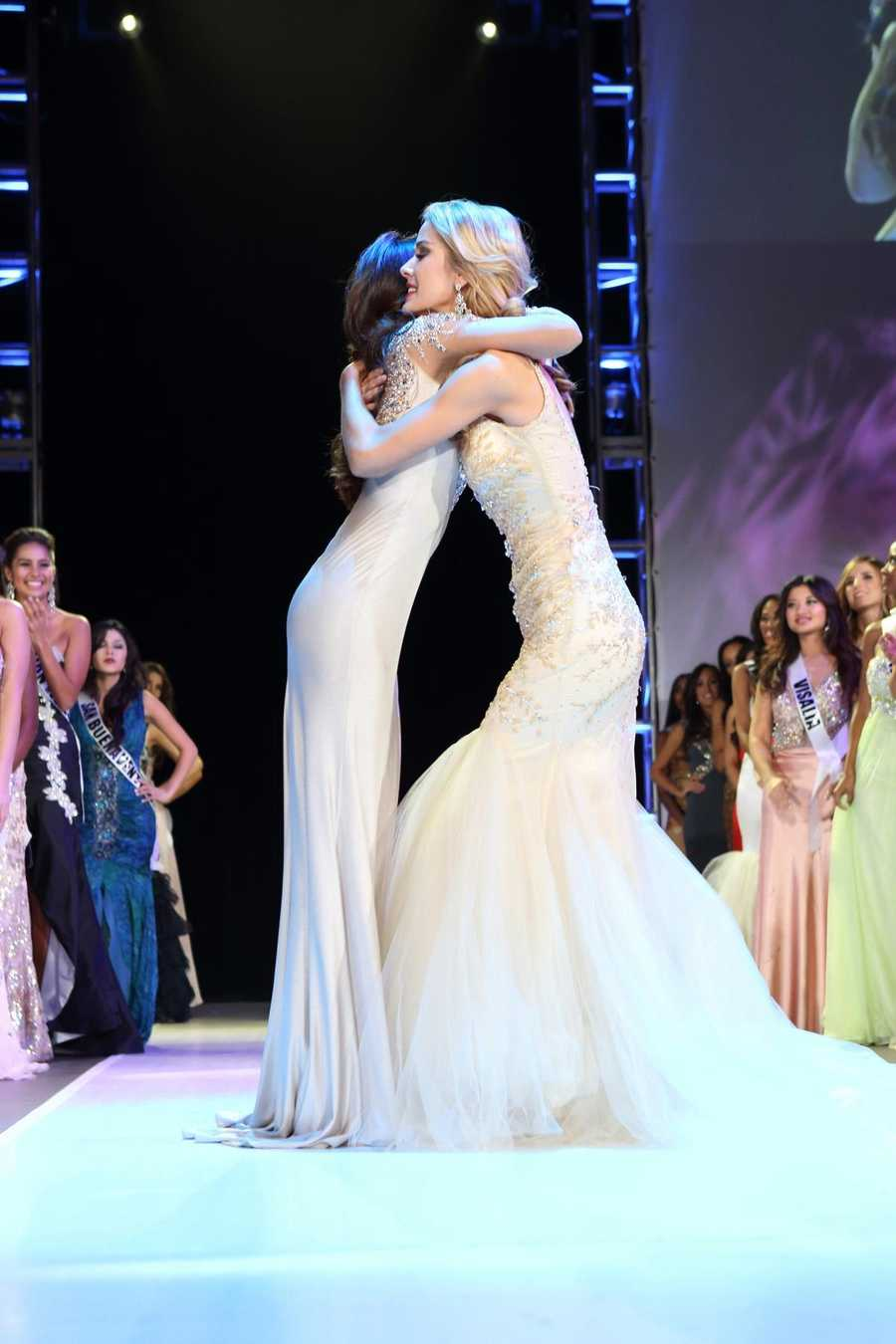 Miss Greater San Diego Mabelynn Capeluj, left, gets a hug from the runner-up after the judges announced that Capeluj is Miss California USA 2013.