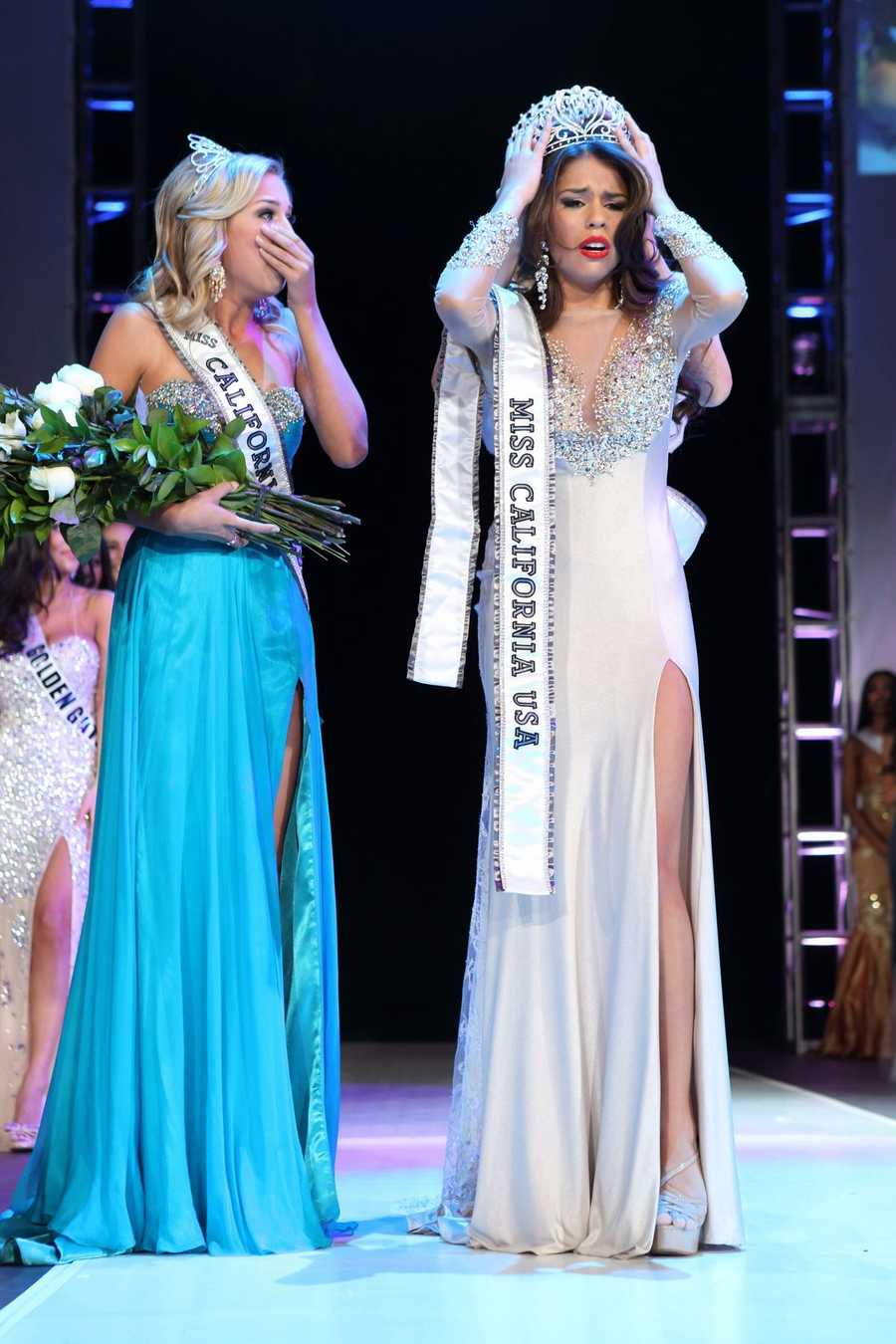 Miss Greater San Diego Mabelynn Capeluj, right, is crowned Miss California USA 2013.