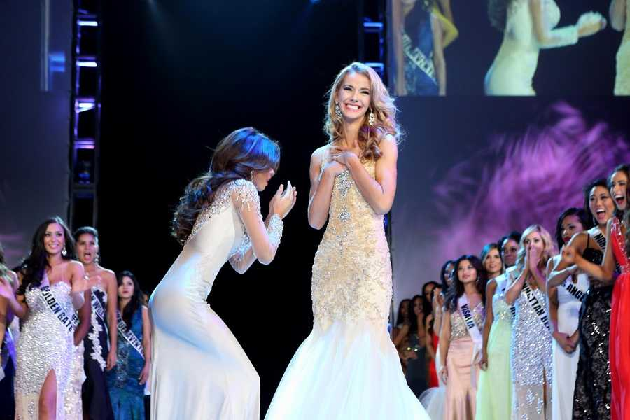 Miss Greater San Diego Mabelynn Capeluj, left, reacts when the judges announce that she is Miss California USA 2013.