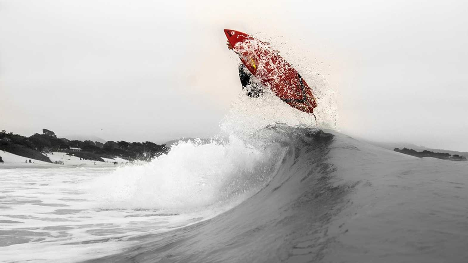 Surfer Wayne Kelly gets some air while surfing off the Monterey Peninsula.