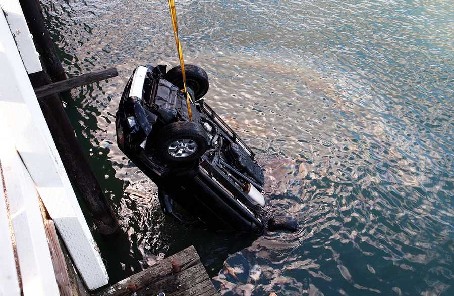 There was a 16-year-old boy, his father, and small dog inside the Toyota 4-Runner at the time of the accident. Officials said the 16-year-old driver mixed up the break pedal with the gas pedal.(Jan. 28, 2013 /Tim Cattera Photography)