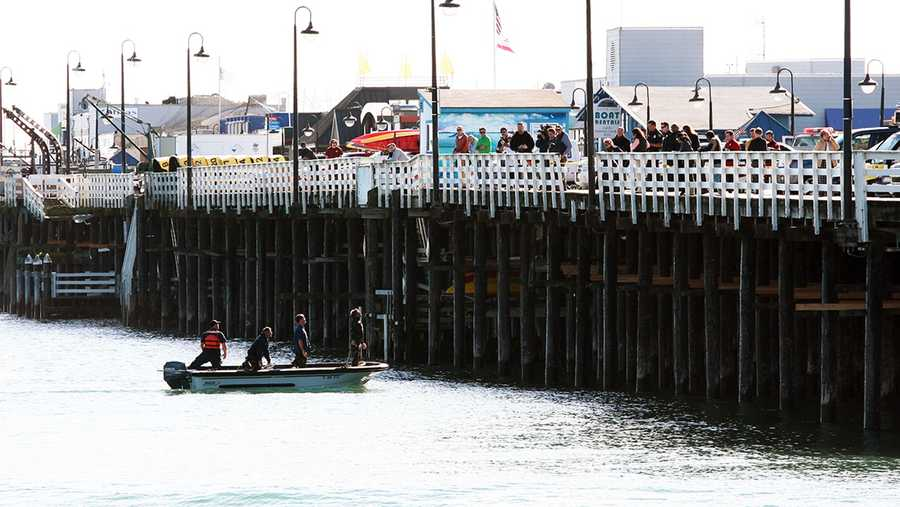 Divers hooked a cable from a tow truck parked on the wharf to the underwater vehicle. After a few failed attempts to lift the SUV, it was successfully lifted onto the wharf at 2:45 p.m. (Jan. 28, 2013)