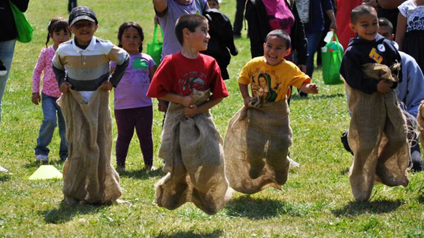 Kids have fun during a potato sack race in Watsonville.