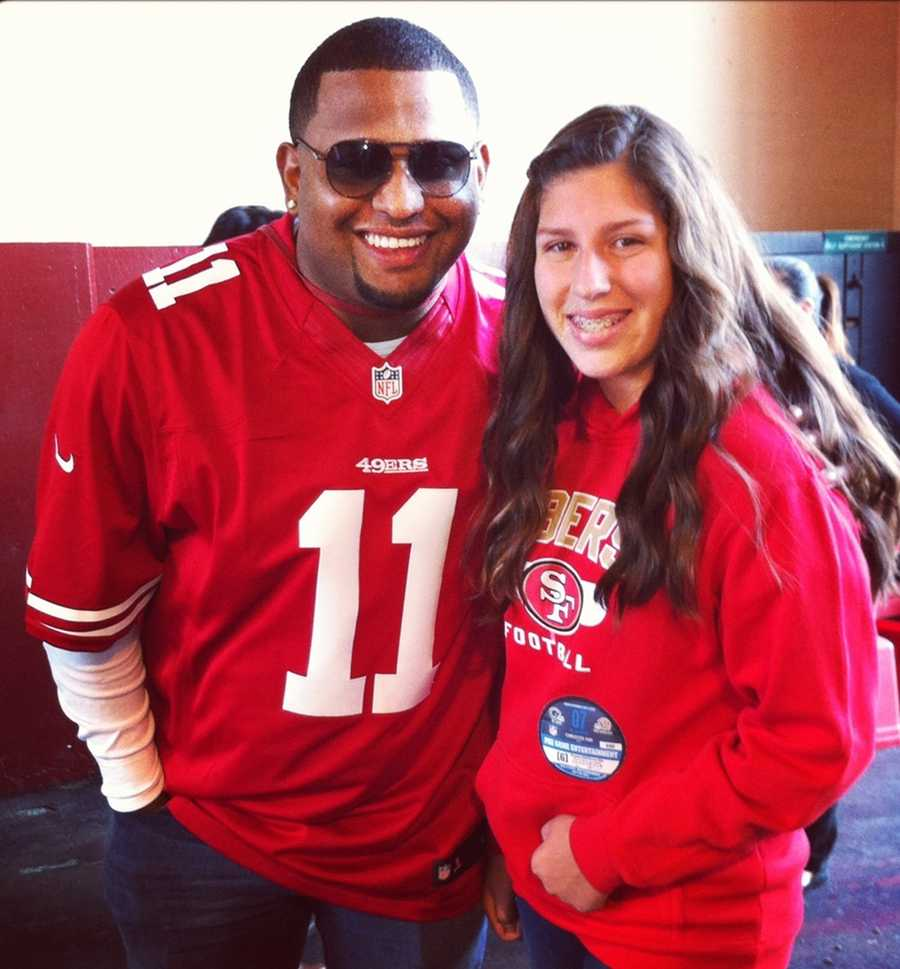 SF Giants 3rd baseman Pablo Sandoval sports a 49ers jersey with a fan from the Central Coast.
