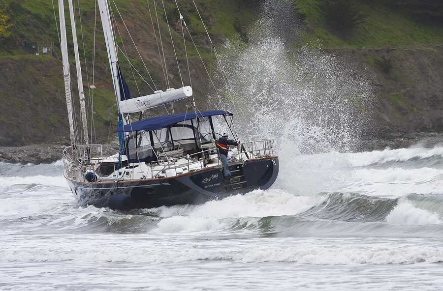 Three people were taken into custody Monday after they stocked a stolen, 82-foot yacht with pizza and beer, and then ran the boat aground on a Pacifica beach, authorities said.Photo by Frank Quirarte / Mavsurfer.com