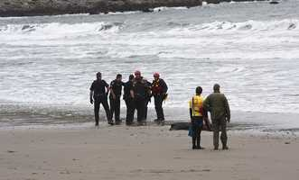 The boat's owner was called out to work with authorities to have it removed from the beach before it was destroyed by the strong surf.Photo by Frank Quirarte / Mavsurfer.com