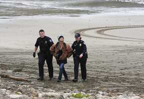 With guns drawn, authorities surrounded the yacht and arrested Leslie Gardner, 63, Dario Mira, 54, and Lisa Modawell, 56, on suspicion of grand theft and conspiracy.Photo by Frank Quirarte / Mavsurfer.com