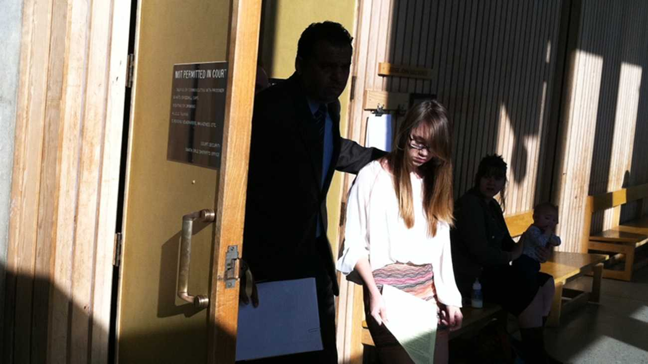 Morgan Triplett walks through Santa Cruz County Court. (March 29, 2013)