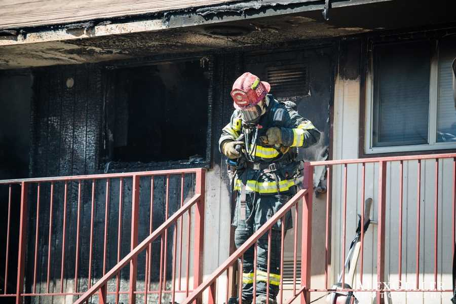 The mother and daughter were rescued by neighbors who jumped into the flames before firefighters arrived.