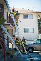One neighbor reported seeing the woman pounding on her apartment's windows while trapped inside the burning apartment.