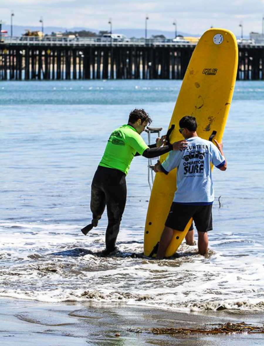 """Operation Surf Santa Cruz is an annual event that honors active duty military soldiers through """"an epic life-changing surfing experience.""""Many of the soldier who participate lost limbs while serving their country fighting in war zones. Soldiers are able to rebuild their confidence and heal in a positive way by learning how to surf with help from legendary professional surfers who live in Santa Cruz."""
