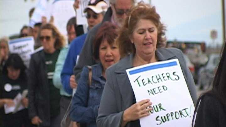 Dozens of teachers gathered to protest in front of the Alisal Union School District board meeting Wednesday night.