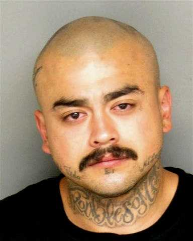 Daniel Sanchez, 25, of Salinas, is one of three men who are charged with shooting at a Salinas police officer during a high-speed chase near Natividad Creek Park in April. He laughed at his arraignment while he was charged with attempted murder.