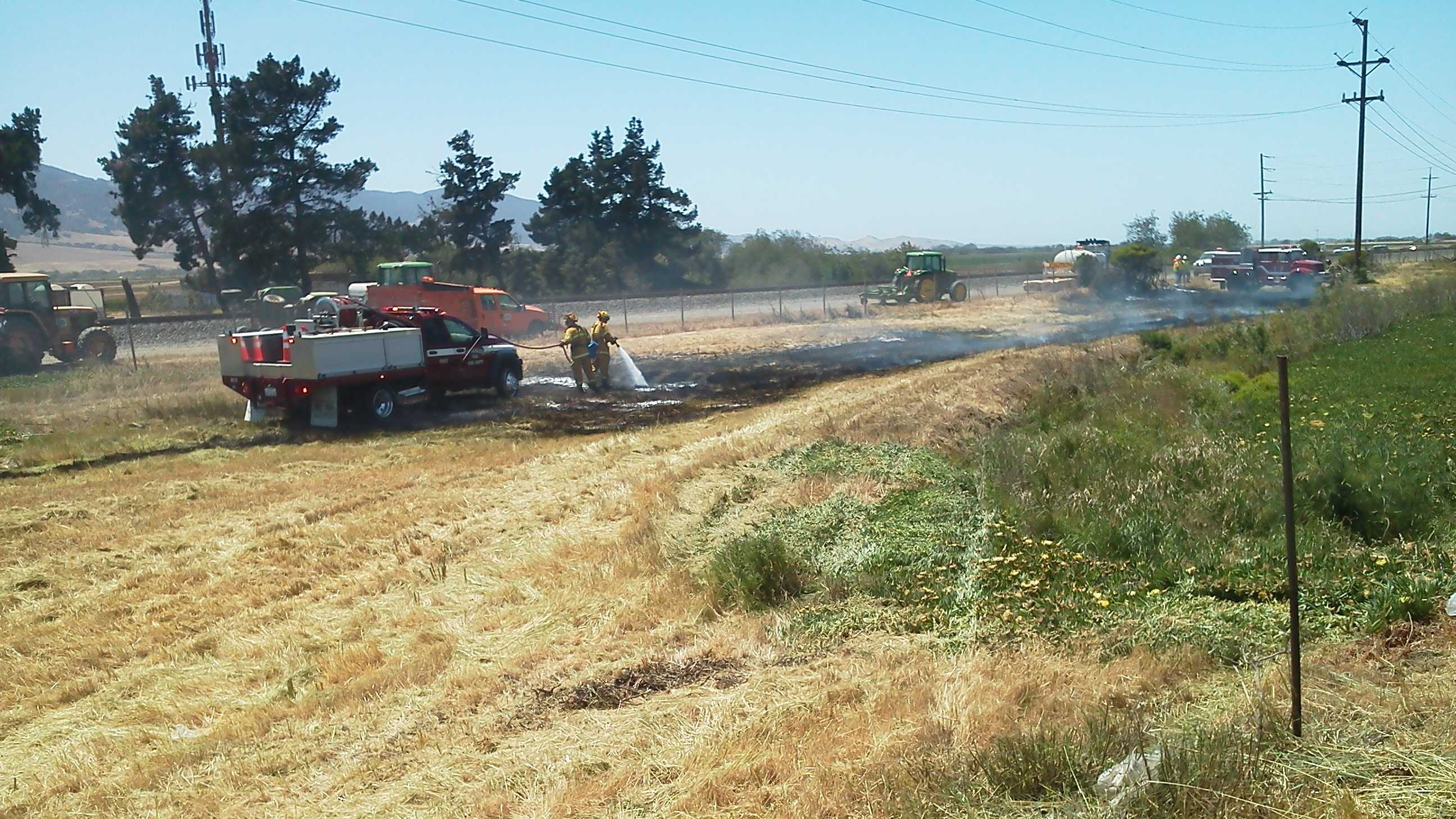 A one-acre vegetation fire was sparked Wednesday by a car fire in Chualar.