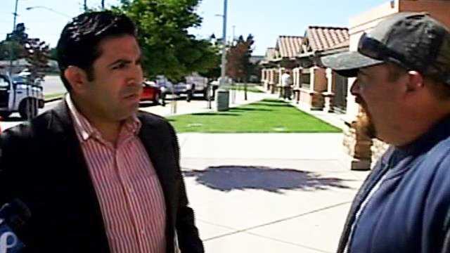 Jose Castaneda talks to Juan Sandoval. (June 20, 2013)