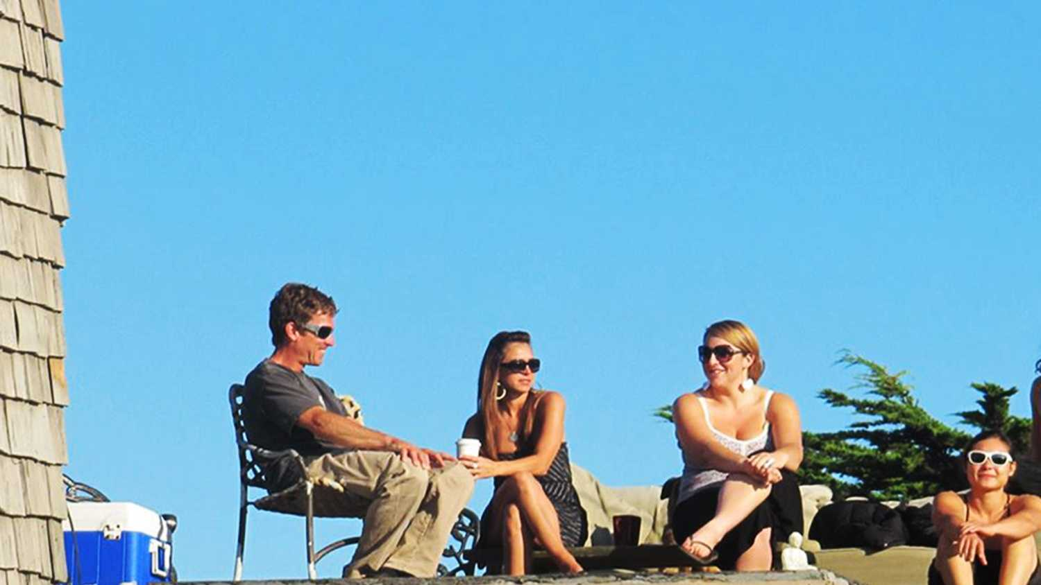 Friends hangout on a sunny rooftop near Pleasure Point in Santa Cruz.