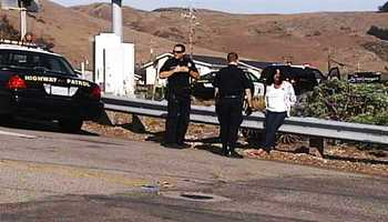 Kathleen Palmer sat on a guardrail while she was arrested Tuesday.