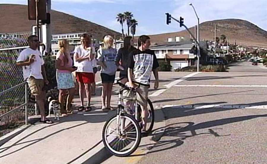 Several motorist and pedestrians saw the dramatic chase unfold across half the Central Coast, including this crowd in Morro Bay.