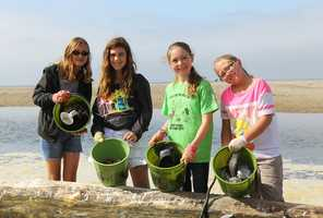 Four girls were all smiles after collecting trash at Rio Del Mar Beach in Aptos with Share Our Shores on July 5.Save Our Shores and 270 volunteers prevented 1,500 pounds of trash and debris from polluting our beaches at 11 sites in Santa Cruz and Monterey counties in the annual July 5th Star Spangled Beach Cleanup.