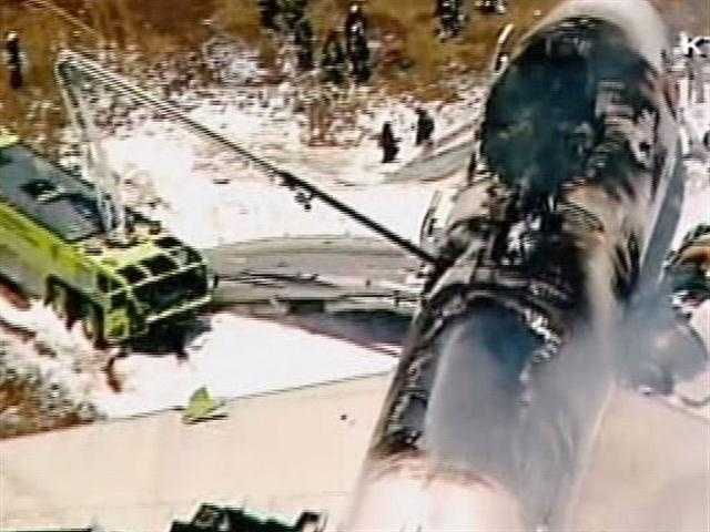 One engine appeared to have broken away. Pieces of the tail were strewn about the runway.