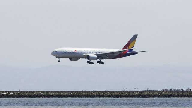 The plane involved in Saturday's crash is seen here landing at the San Francisco International Airport in May. Asiana purchased the plane, a Boeing 777-200, in March 2006.