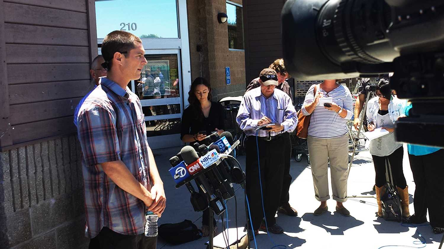 Elliot Stone, left, talks about what he witnessed during the San Francisco plane crash. (July 9, 2013)