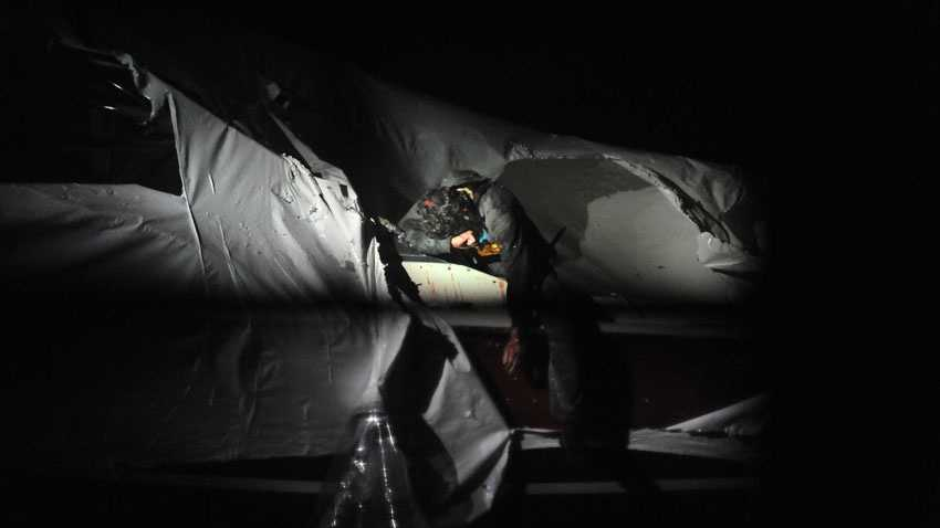 Boston Marathon bombing suspect Dzhokhar Tsarnaevslumps across the deck of the trailered boat the night he was found and captured.