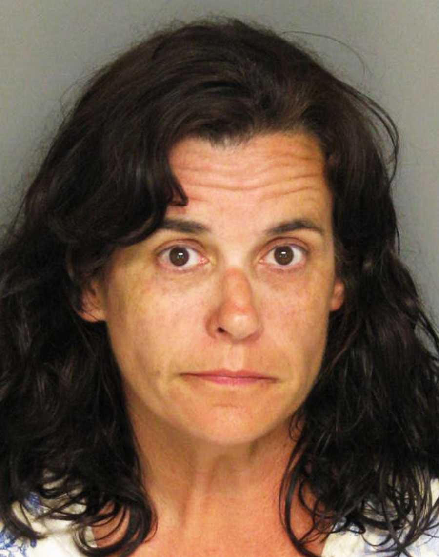 "Kathleen Palmer, 49, of Marina, lead the California Highway Patrol on a high-speed chase from Marina to Morro Bay until she was finally stopped with a spike strip and K-9 dog.During the 3-hour chase across half the Central Coast, CHP Officer Robert Lehman said the driver was drunk and high as she raced at speeds topping 105 mph.The incident started when Palmer drove erratically around town in a Jeep and made terrorist threats toward random people, Marina police Cmdr. Bob Nolan said. She yelled at CSU Monterey Bay college students who were playing a game of Frisbee golf, and threw things at PG&E workers, Nolan said.Police said they were called at 3 p.m. because Palmer filled up her Jeep's gas tank at a 76 gas station and left without paying, Nolan said.As CHP officers raced behind her and a helicopter flew overhead, the woman hit the accelerator and zigzagged as she drove on Del Monte Boulevard, Nashua Road, Cooper Road, Highway 1, Blanco Road and Reservation Road.She drove 80 mph on surface streets before she hopped on Highway 68, sped westbound to Monterey, and continued south on Highway 1 through Carmel and Big Sur.She managed to swerve around multiple spike strips, and the black Jeep reached speeds of 105 miles per hour as she neared the San Luis Obispo County line at 4:30 p.m., CHP officers said.The Jeep was finally slowed down in Morro Bay when it rolled over a spike strip. Even though her tires were reduced to shreds, the driver kept going on just rims for 10 minutes until the Jeep crashed into a ditch.Witness Grady Bell saw the Jeep zoom past him out of control in Morro Bay just before it wrecked.""All of a sudden I heard the sirens. I looked over, and I saw a car driving through the intersection on three wheels,"" Bell said.Palmer sprinted out of her Jeep and ran until she was tackled by a K-9 dog, CHP Officer Don Coats said.CHP officer Robert Lehman said investigators do not know why Palmer fled. She was booked into the Monterey County Jail and faces charges of reckless driving, evading arrest, and DUI."