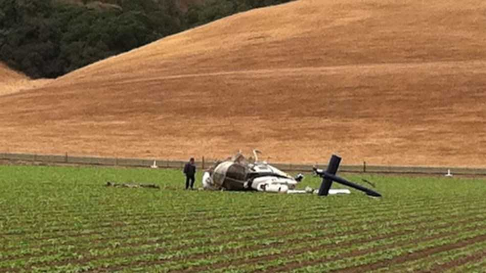 A helicopter that had just finished spraying pesticides crashed into a field in the 1000 block of River Road near Gonzales on Sunday, officials said.