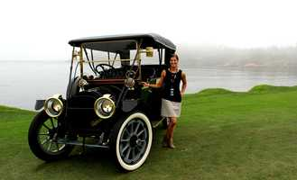 KSBW Digital Media Manager Amy Larson smiles with her cousin's Packard that won best of its class.