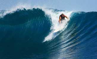 Greiner is seen here surfing.