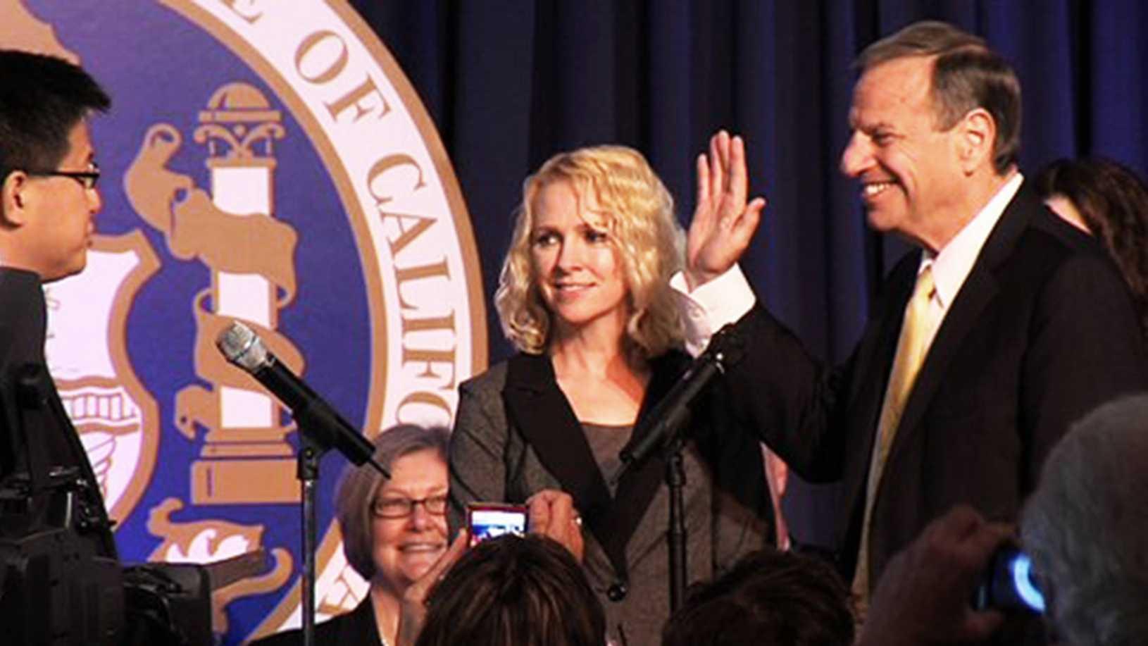 This is San Diego Mayor Bob Filner being sworn in as mayor with his then-fiance Bronwyn Ingramsmiling next to him.