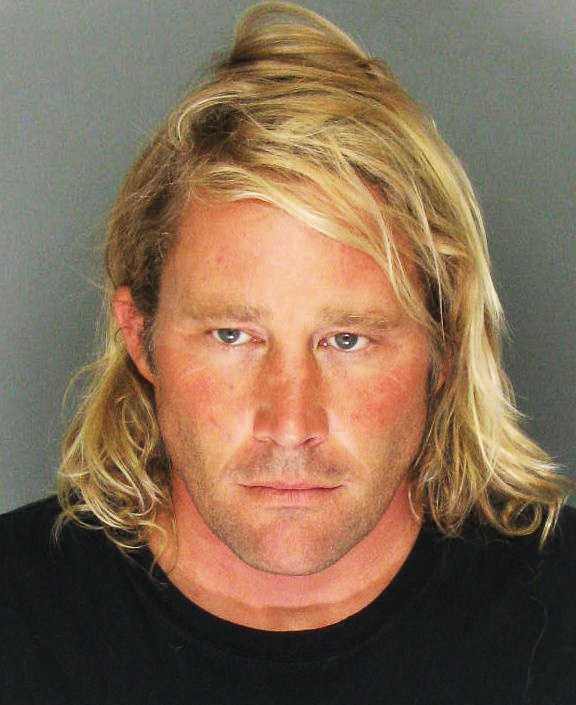 Dylan Greiner, 38, of Santa Cruz, is accused of sexual relationships with 13 and 14 year old girls he taught at Santa Cruz Surf School and of hiding a secret video camera in his surf school's dressing room. The popular surfer's arrest shocked his community and a judge set his bail at $1 million.
